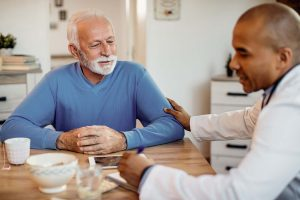 Male Nurse with male paitient in home First Care Home Services miami broward_